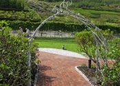 The large Malvern flower arch, by Ironart of Bath - installed at the Eden Project, Cornwall