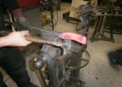 Jason Balchin forming the wrap detail in the Ironart workshops, Bath