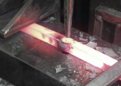 Punching the bar in the Ironart workshops