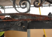 Rust jacking and decay where the original overthrow is fixed to the modern support beam