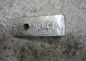 "A makers stamp located on one of the wrought iron hangers. ""Edmand Maa"" is all that we can see..."