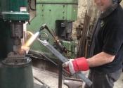 Dom West - forging bespoke latches at Ironart