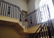 Wrought iron staircase with cast iron panels
