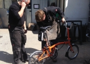 Jason Balchin and Luke Hannaford figure out the assembly of Ironart's brand new Brompton Bike