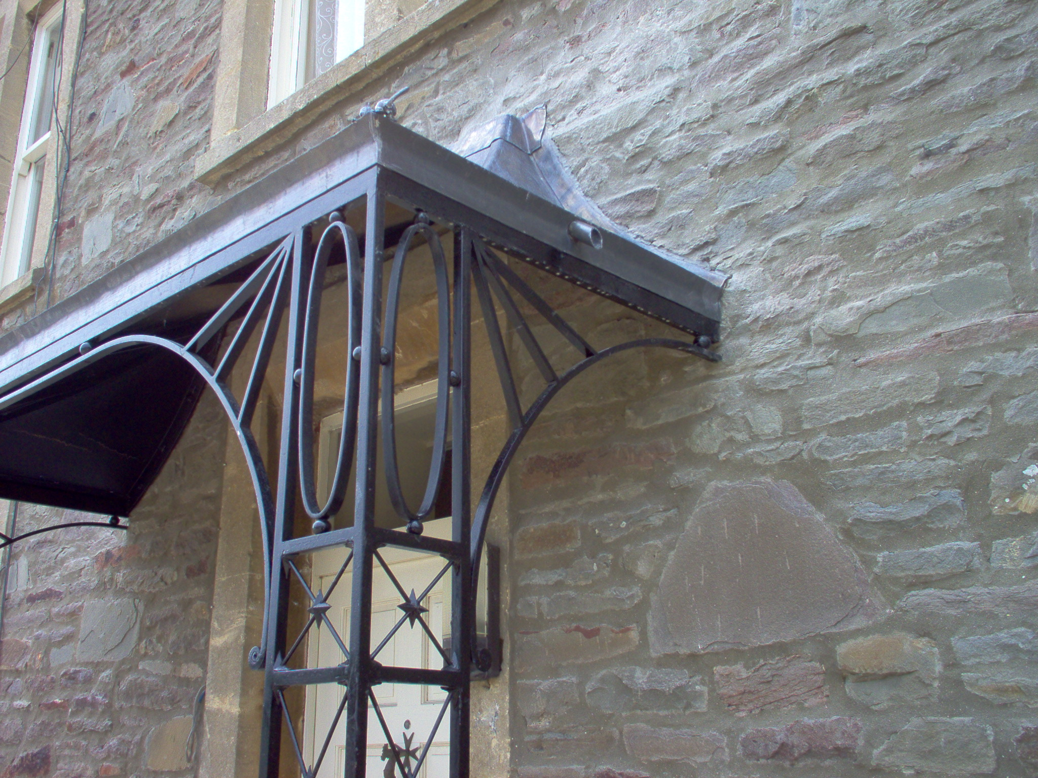 Lead And Wrought Iron Porch With Star Detailing
