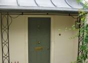 Decorative wrought iron porch on Church Lane, Widcombe