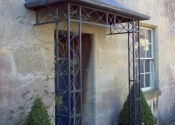 Decorative lead and wrought iron porch, Colerne High Street