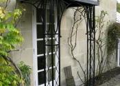 Lead and wrought iron porch on Hamilton Road, Lansdown, Bath