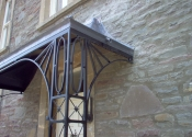 Lead and wrought iron porch with lead star detailing