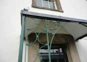 Restoration of an historic iron porch with lead cast detail - Westcombe, Somerset
