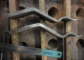 Replacement forged section, made using reclaimed wrought iron bar