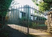 Wrought iron bow topped double gates at Bathford, near Bath