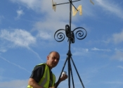 Ironart's Martin Smith reinstates the restored weathervane at St Mary's Church, Mudford