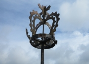 The crown finial on the weathervanes at Evesham Abbey Tower