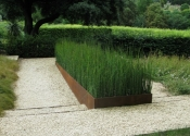 Contemporary rusted steel raised planting beds