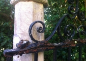 Rust jacking at St Mary Tory chapel Gates, Bradford on Avon. Prior to restoration