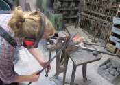 Cecilie Robinson at work on the refurbishment of the chapel gates of St Mary Tory, Bradford on Avon