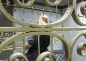 Repainting the restored gates for St Mary Tory, Bradford on Avon