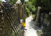 Reinstalling the gates at St Mary Tory chapel, Bradford on Avon, Wilts