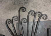 Cecilie Robinson - hot forged scrolls for the Abbey Hotel, Bath - cake stands.