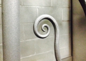 Hot forged scroll detail of the sun panel made by James Cuthbertson, Ironart of Bath