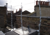 A decorative wire trellis for a London roof garden