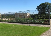 A large galvanized mild steel fruit and vegetable cage pergola with netting