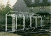 Wrought iron hooped arch pergola