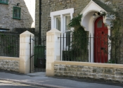 Wrought iron gate and railings in Vicarage Street, Frome, Somerset