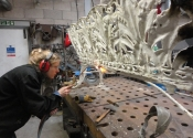 Cecilie Robinson dismantling the cast iron bench