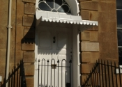 Restored and refitted - door canopy on Cavendish Crescent, Bath