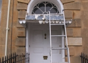 Restoration of three zinc covered door canopies on Georgian Cavendish Crescent in Bath.