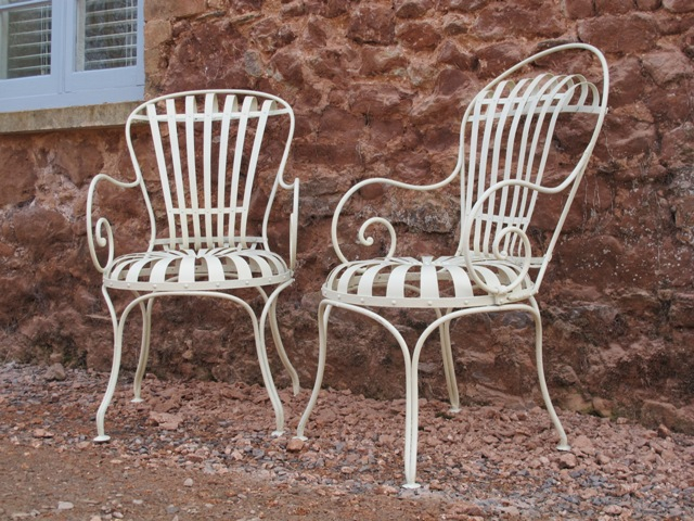 A pair of french chairs ironart of bath French metal garden furniture