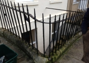 Gate and railings on Rivers Street Bath, prior to restoration