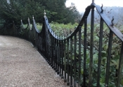 The Ironart restoration team reinstating the restored railings at Chalford