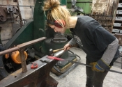 NADFAS student Cecilie Robinson working on the restoration of the Chalford railings