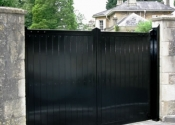 Sheeted metal double security gates