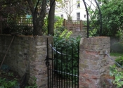 Single metal gate with a matching arch, Maida Vale, London