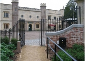 Single wrought iron gate with railings at Ashton Court in Bristol