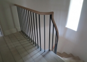 The curving bespoke stair balustrade complete with its oak handrail