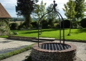 Chiddon Well head and wrought iron overthrow