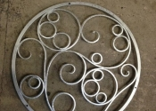 Decorative metal well cover by Ironart of Bath