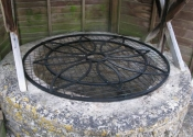 Wrought iron well covers by Ironart of Bath - Flower design
