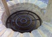Concentric ring well cover by Ironart of Bath