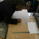 Jason creating scale drawings in the Ironart workshop