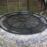 Wrought iron well cover