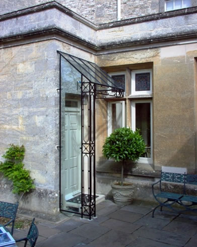 Glass sided wrought iron porch ironart of bath for Modern glass porch designs