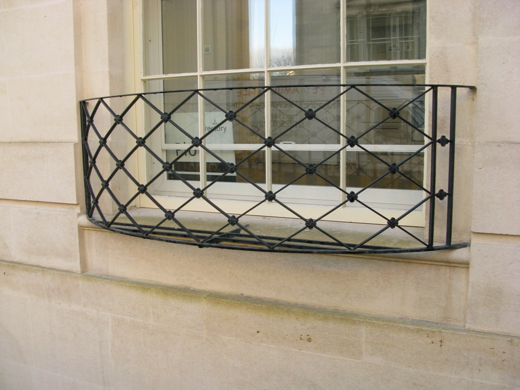 A balconet or balconette is an architectural term to describe a false balcony, or railing at the outer plane of a window-opening reaching to the floor, and having, when the window is open, the appearance of a .