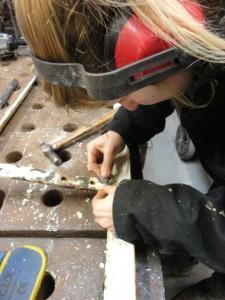 Cecilie restoring Coalbrookedale bench (1)