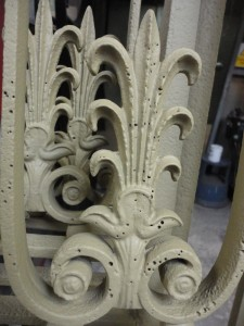 Iron frame detail post treatment but requiring filling due to porosity in the castings